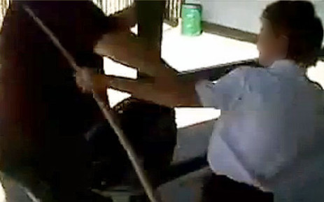 A screengrab from a cellphone video which shows a Grade 8 Glenvista High School pupil assaulting a teacher with a broom.
