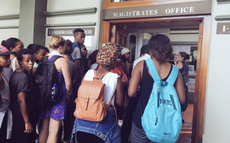 Rhodes University students activists stand outside the magistrate court after the arrests of the five students during the anti-rape protests on 20 April 2016. Picture: Govan Whittles/EWN.