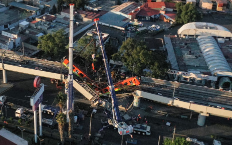An aerial view shows the site of a metro train accident after an overpass for a metro partially collapsed in Mexico City on 4 May 2021. Picture: Pedro Pardo/AFP