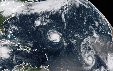 FILE: This NOAA/RAMMB satellite image taken at 13:30 UTC on 9 September 2018, shows (L-R) Tropical Storm Florence, Tropical Storm Isaac and Tropical Storm Helene in the Atlantic Ocean. Picture: AFP.