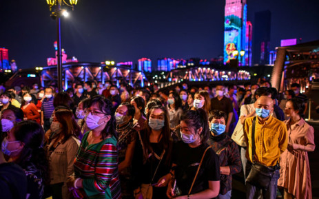 Passengers wearing facemasks as a preventive measure against the COVID-19 coronavirus wait to board a last century-style boat, featuring a theatrical drama set between the 1920s and 1930s in Wuhan, in China's central Hubei province on 27 September 2020. Picture: AFP
