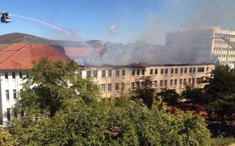 Firefighters try and bring a fire at Stellenbosch University s Van der  Sterr Building under control on 9625629cc