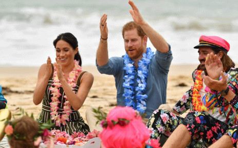 """Britain's Prince Harry and his wife Meghan, Duchess of Sussex attend a """"Fluro Friday"""" session run by OneWave, a local surfing community group who raise awareness for mental health and wellbeing, at Sydney's iconic Bondi Beach on 19 October, 2018. Picture: AFP."""