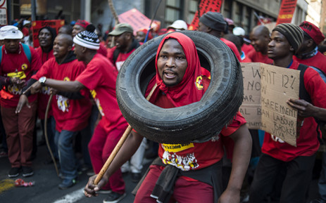 FILE: The NUM said workers were travelling in company supplied busses when other workers started pelting the vehicles with stones. Picture: AFP.