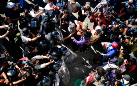 A screengrab of migrants in Mexico trying to rush through the US border. Picture: CNN