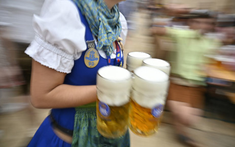FILE: A waitress carries beer glasses in a beer tent at the Oktoberfest beer festival in Munich, southern Germany, on 22 September 22, 2019. Picture: AFP