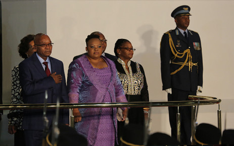 President Jacob Zuma and his wife Nompumelelo Ntuli stand for the national anthem and the 21 gun salute.