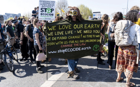 FILE: Climate change activists continue to block the road on Waterloo Bridge in London on 20 April 2019, on the sixth day of an environmental protest by the Extinction Rebellion group. Picture: AFP.
