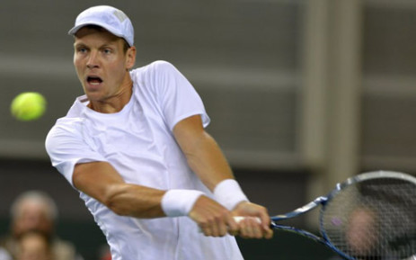 Tomas Berdych of the Czech Republic returns a ball on 1 February, 2013 to Henri Laaksonen of Switzerland during the Davis Cup World Group first round match between Switzerland and the Czech Republic in Geneva. Picture: AFP