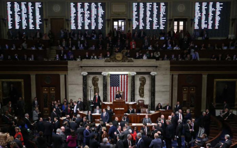 The vote count is projected on the walls of the House of Representatives as Speaker of the House Nancy Pelosi (D-CA) presides over voting on the second article of impeachment of US President Donald Trump at in the House Chamber at the US Capitol 18 December 2019 in Washington. Picture: AFP.