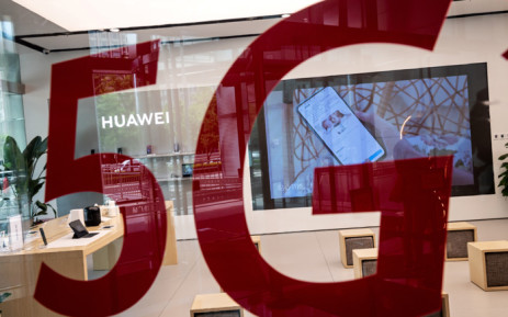 FILE: A shop for Chinese telecom giant Huawei features a red sticker reading '5G' in Beijing on in May 2020. Picture: AFP.