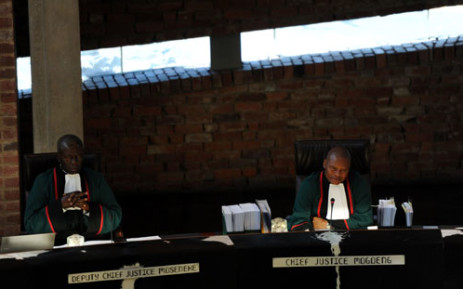 Chief Justice Mogoeng Mogoeng (R) and deputy Chief Justice Dikgang Moseneke during a case at the Constitutional Court in Johannesburg on 15 August 2012. Picture: SAPA
