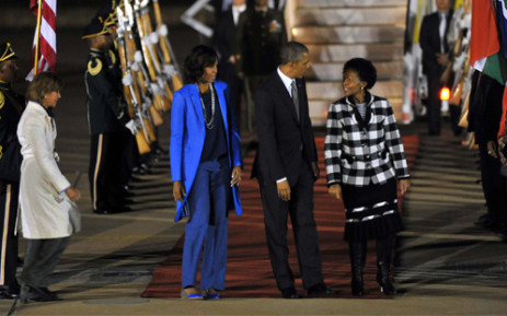 US President Barack Obama and his wife Michelle are received by Minister of International Relations and Cooperation Maite Nkoana-Mashabane after landing at the Waterkloof Airforce Base in Pretoria on Friday evening, 28 June 2013. Picture: GCIS/SAPA