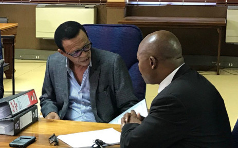 Advocate Lawrence Mrwebi (left) speaks to his legal counsel during the Mokgoro Inquiry into his fitness to hold office on 21 January 2019. Picture: EWN