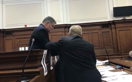 Convicted wife killer Jason Rohde talks to his lawyer in the High Court in Cape Town during his sentencing proceedings. Picture: Shamiela Fisher/EWN