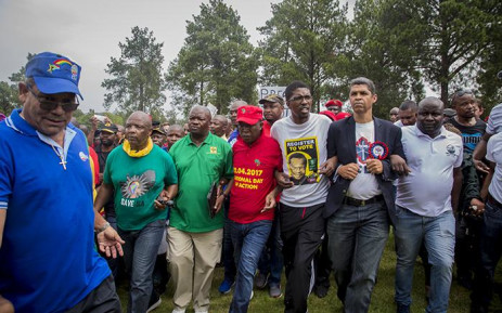 Members of several opposition parties link arms as they walk across the lawns of the Union Buildings in Pretoria at the Day of Action march against the leadership of President Jacob Zuma on 12 April 2017. Picture: Reinart Toerien/EWN