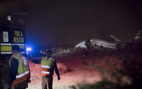 FILE: Paramedics and emergency services staff gather at the scene of a plane crash near Wonderboom Airport in northern Pretoria. Picture: Sethembiso Zulu/EWN