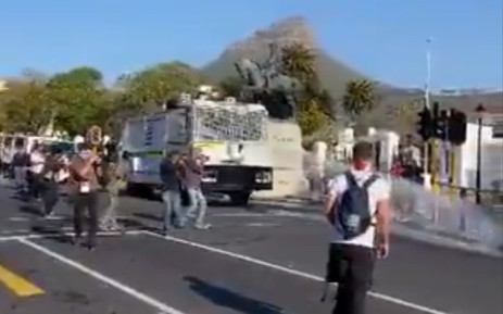 A screengrab of police using water cannons to disperse protesters outside Parliament on 24 July 2020.