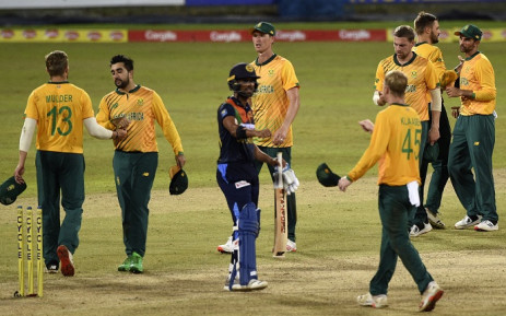 South Africa's captain Keshav Maharaj (R) celebrates with teammates after South Africa won by 28 runs during the first international Twenty20 cricket match between Sri Lanka and South Africa at the R Premadasa Stadium in Colombo on 10 September 2021. Picture: Ishara S. Kodikara/AFP