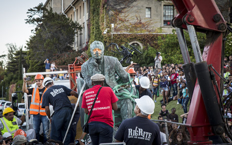 FILE. The controversial statue of Cecil John Roads sits on the back of a truck before being driven off the University of Cape Town campus on 9 April 2015. Picture: Aletta Gardner/EWN