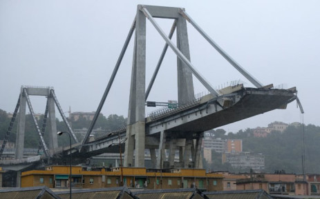 A picture taken on 14 August 2018 in Genoa shows a view of the Ponte Morandi motorway bridge after one of its section collapsed injuring several people. Picture: AFP
