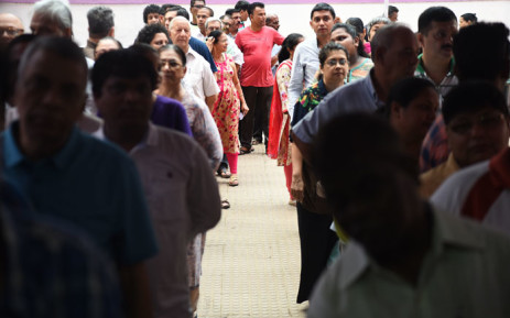 Indian voters wait for start of voting at a polling booth in Mumbai on 29 April 2019. Voting began for the fourth phase of India's general parliamentary elections. Picture: AFP