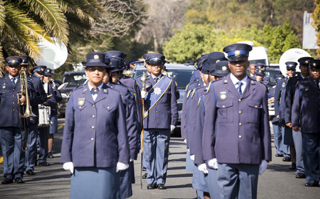 FILE: Police honour guard march outside the Dutch Reformed Church in Somerset West after Warrant Officer Holz's funeral. Picture: Thomas Holder/EWN