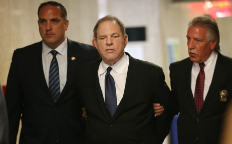 Harvey Weinstein is escorted in handcuffs into the State Supreme Court after on Monday for arraignment on charges alleging he committed a sex crime against a third woman on 9 July 2018 in New York City. Picture: AFP