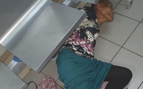 Martha Marais (76) tied to a steel bench and lying on the floor at Mamelodi Hospital. Picture: Virginia Keppler/Facebook