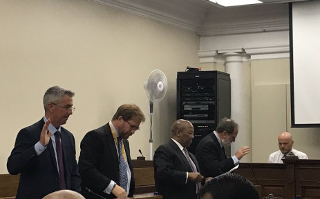 Nicki Oppenheimer, his son Jonathan, directors Manne Dipico and Robbie Irons take an oath before Parliament's home affairs committee to discuss operations at the Fireblade Aviation Terminal at OR Tambo International on 30 October 2018. Picture: Lindsay Dentlinger/EWN