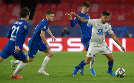 """(From left) Chelsea's Ben Chilwell, Jorginho and Mason Mount challenge FC Porto forward Jesus Corona """"Tecatito"""" during the UEFA Champions League quarterfinal second leg football match between Chelsea and Porto at the Ramon Sanchez Pizjuan stadium in Seville on 13 April 2021. Picture: Cristina Quicler/AFP"""