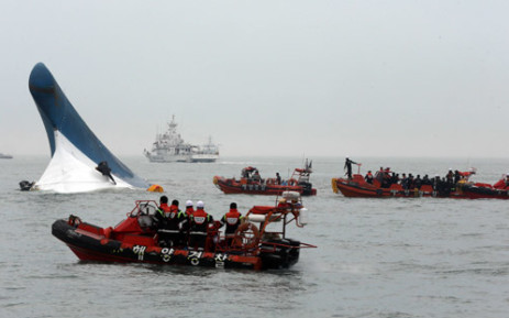 FILE: South Korea Coast Guard members searching for passengers near a South Korean ferry after it capsized on its way to Jeju island from Incheon on 16 April 2014. Picture: AFP