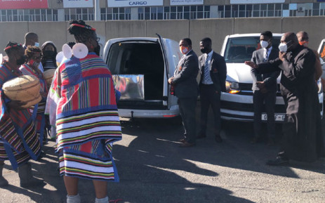 A traditional ceremony takes place following the arrival of Kgothatso Mdunana's remains at the OR Tambo International Airport on 7 June 2021. Picture: Mia Lindeque/Eyewitness News