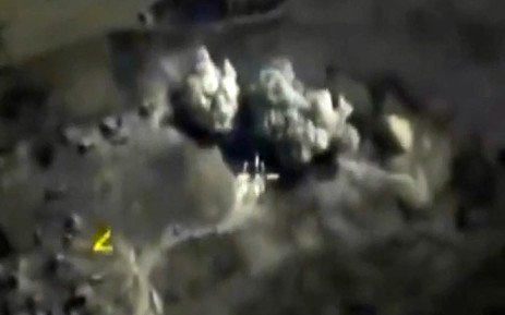 A video grab made on 3 October, 2015, shows an image taken from a footage made available on the Russian Defence Ministrys official website, purporting to show an explosion after airstrikes carried out by Russian air force on what Russia says was an underground explosives warehouse in Raqqa. Picture: AFP.