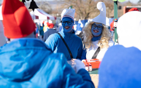 Vendors take part in a gathering of people dressed as smurfs (small blue fictional creatures created by Belgian cartoonist Pierre Culliford) to be counted as part of a world record attempt on 16 February 2019 in Lauchringen, Germany. Picture: AFP