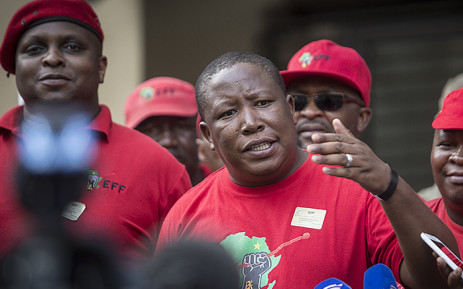 EFF leader Julius Malema addressed the media outside the Constitutional Court in Johannesburg on 09 February 2016 following the Nkandla showdown. Picture: Reinart Toerien/EWN.