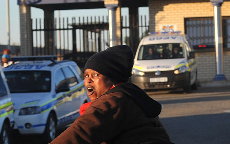 """""""Police used tear gas and rubber bullets to disperse protesters in Soweto who were reportedly baring their bottoms to motorists driving by on 11 June 2014. Picture: The Star"""