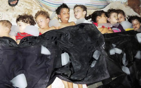 An image released shows the bodies of children after Syrian rebels claim they were killed in a toxic gas attack by pro-government forces in eastern Ghouta. Picture: AFP/Local Committee of Arbeen