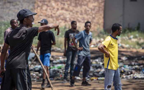 Residents of Reiger Park and Joe Slovo hurl rocks at each other during clashes over illegal power connections. Picture: Thomas Holder/EWN.