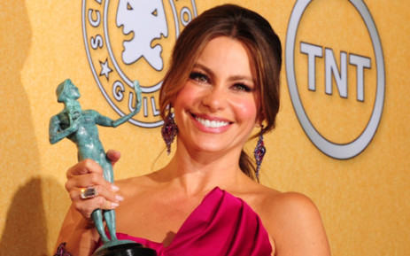 Actress Sofia Vergara holds the award for Outstanding Performance By An Ensemble In A Comedy Series. Picture: AFP