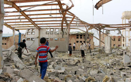 Yemenis inspect the damage caused by a Saudi-led air strike on a cholera treatment centre supported by Doctors Without Borders (MSF) in the Abs region of Yemen on 11 June 2018. Picture: AFP.