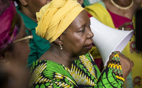 Former African Union (AU) chairperson Nkosazana Dlamini-Zuma raises her fist during songs sung by ANC supporters after her arrival from Ethiopia at OR Tambo International Airport in Johannesburg on 15 March 2017. Picture: Reinart Toerien/EWN
