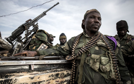 FILE: Soldiers of the Armed Forces of the Democratic Republic of the Congo (FARDC) sit in a truck bed in a base on 3 July 2019 in Djugu, eastern DR Congo. Picture: AFP