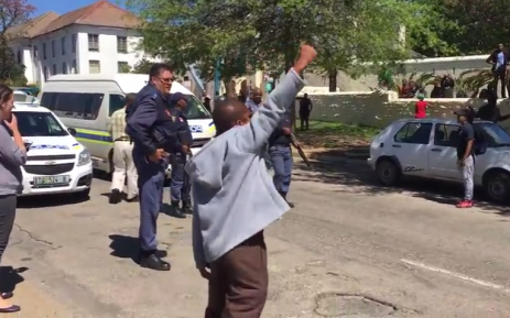 This video screengrab shows a student leading chanting at Rhodes University on 28 September 2016. The man was later dragged on the ground before being arrested by police.