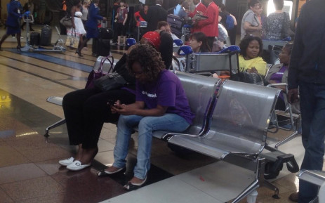 Members of the Emmanuel church seated in arrivals terminal after returning from Nigeria today. Picture: Govan Whittles/EWN