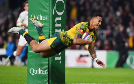 FILE: Australia's full-back Israel Folau scores a try during the international rugby union test match between England and Australia at Twickenham stadium in south-west London on 24 November 2018. Picture: AFP