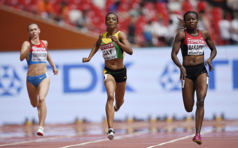 """FILE: Jamaica's Christine Day (C) and Kenya's Joyce Zakary compete in the heats of the women's 400 metres athletics event at the 2015 IAAF World Championships at the """"Bird's Nest"""" National Stadium in Beijing on 24 August, 2015. Picture: AFP."""