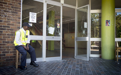 FILE: A security guard keeps watch outside B Block on the UWC Bellville campus after protesters damaged buildings and property the previous day. Picture: Aletta Harrison/EWN.