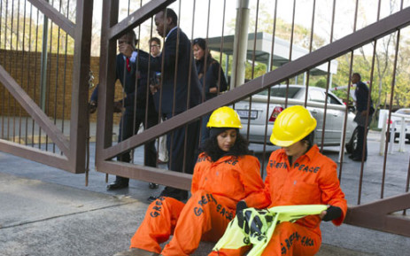FILE PICTURE: Greenpeace protesters chain themselves to a fence at the Industrial Development Corporation in Sandton. They were protesting against the use of nuclear energy in Africa. Picture: Shayne Robinson, Freelance Photojournalist.