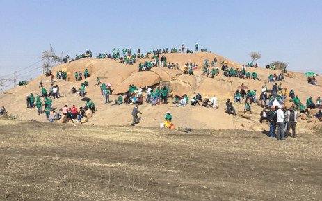 FILE: Miners sit at the 'koppie' in Marikana ahead of a programme to commemorate the Marikana massacre, on 16 August 2018. Picture: Pelane Phakgadi/EWN
